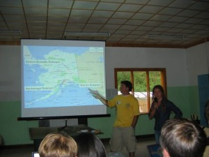 John Pile Jr presents to a group of Siberian Rotaractors about the organization in Alaska.